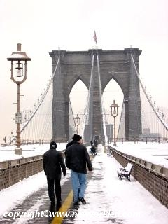 Photo of Folks crossing the Brooklyn Bridge at the end of this Snow Storm