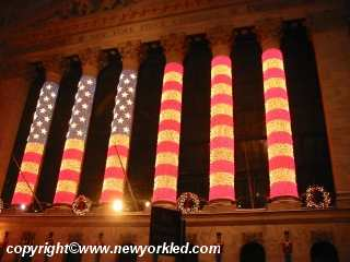 Our Flag in bright lights above the entrance to the NY Stock Exchange.