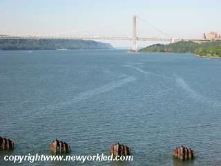 A photo of the GWB far off up the Hudson River.