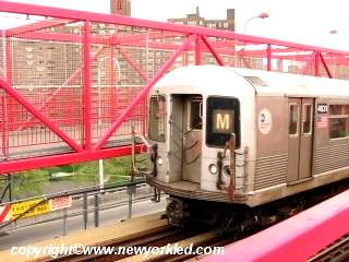 Photo of the M train as it crosses the bridge.