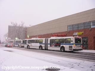 Photos here of a number of city buses picking up passengers.