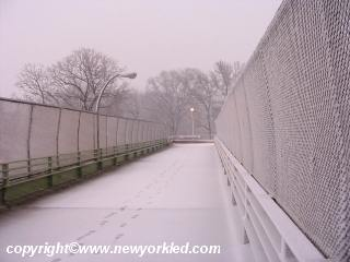 Photo of one of the bridges crossing I-95 in the Bronx from Pelham Bay Park. Notice the footprints in the snow.