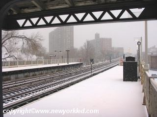 Snow on el train station in the Bronx.