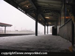 The platform is empty at this one station near the beginning of the storm.