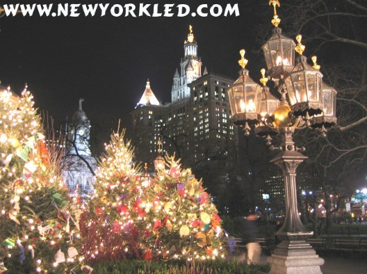 Photo of the decorations surrounding the fountain at City Hall Park. In the distance is the Municipal Building.