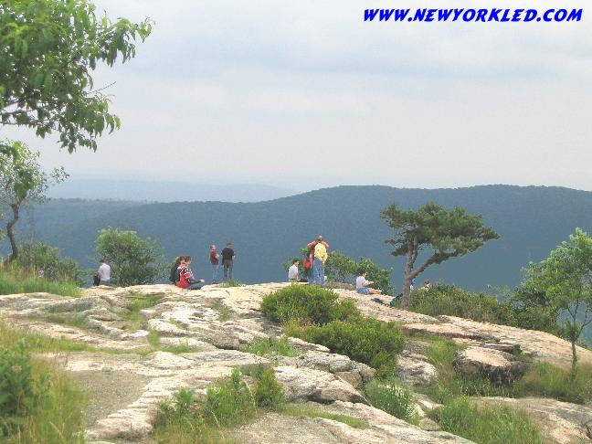 Many folks venture out onto the cliffs atop Bear Mountain near the Perkins Memorial Tower.