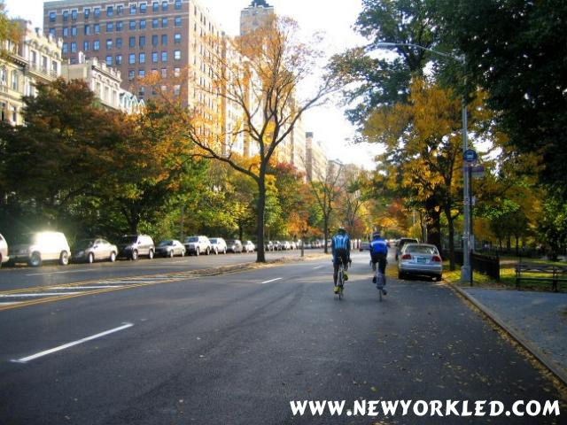Two Cyclists pedal along Riverside Drive as they head south on this Manhattan Street.