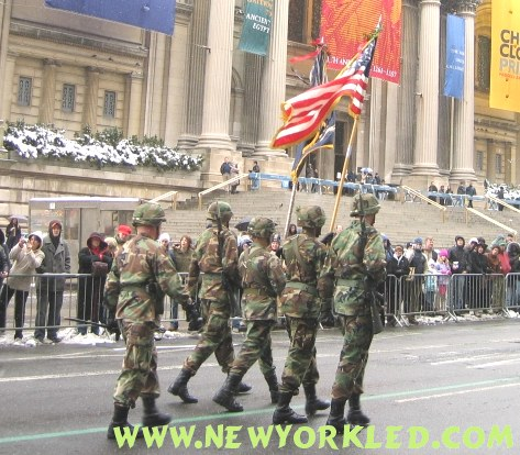 Army Soliders march along carrying these great flags of great symbolism.