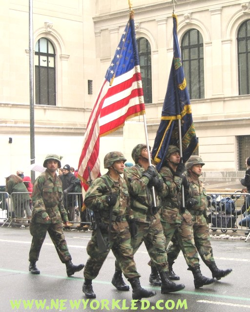 Soldiers marching along 5th avenue and strapping our flags.