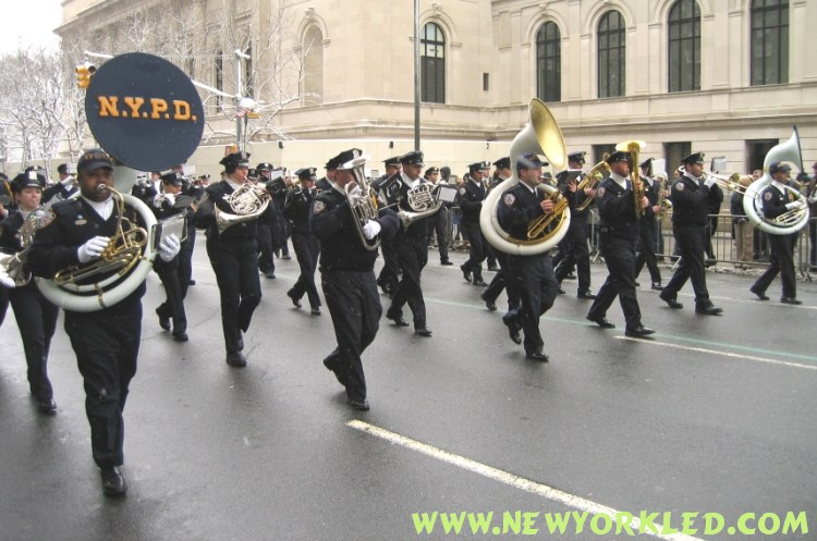 The NYPD Marching Band marches along in front of the Museum on the upper east side of Manhattan.