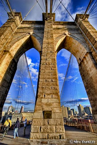Wide angle view of the arches of one of the Brooklyn Bridge towers.