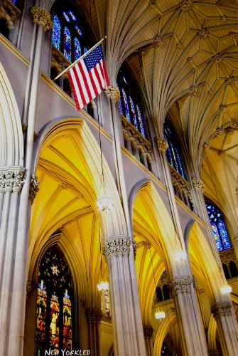 This image features one interior side of the Cathedral and the American Flag which hangs overhead.